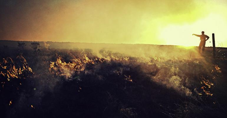 In Montana, ARS ecologist Lance Vermeire tracks a range fire in a study of post-fire grass regrowth.