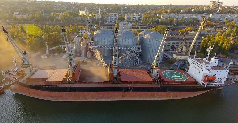 Aerial view of big grain elevators on the sea.