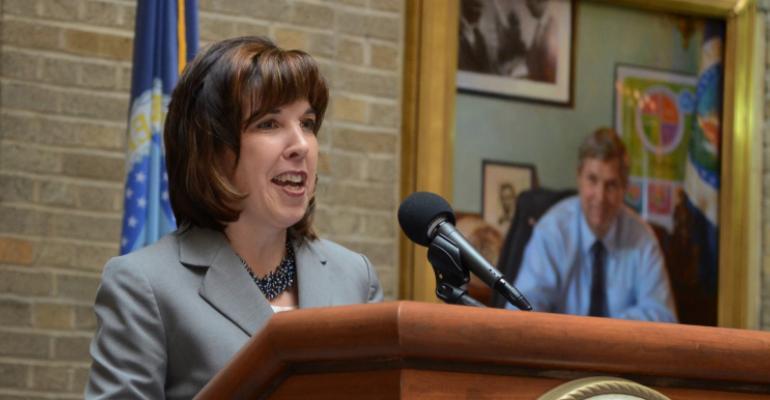 assistant to the secretary on rural development Ann Hazlett speaks at USDA building