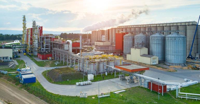 Beautiful sunset over biofuel factory