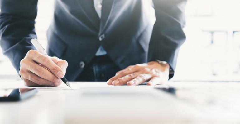 Businessman signing contract_ijeab_iStock_Thinkstock-659493026.jpg