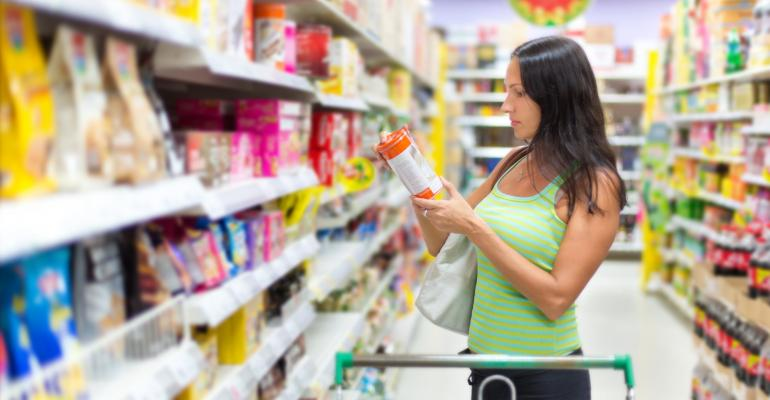 Grocery shopping woman checking food labels consumer