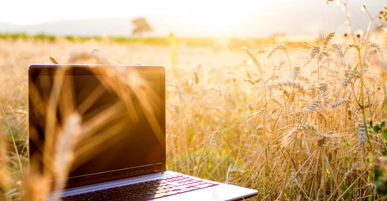 Laptop in rural wheat field with broadband internet