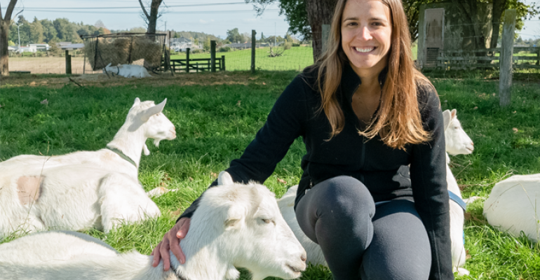 Dr. Gosia Zobel with goats