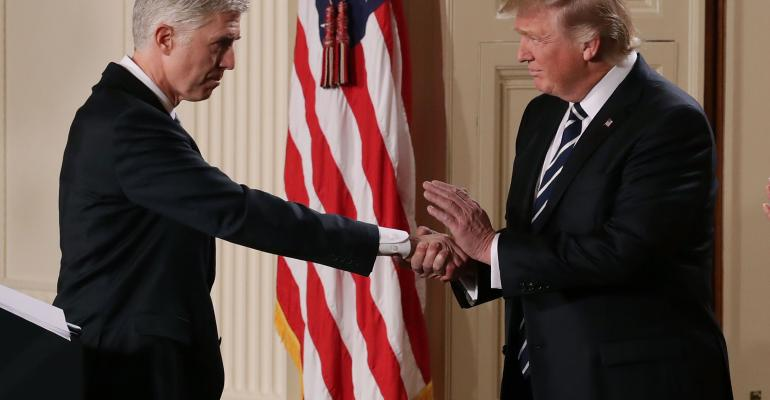 President Donald Trump and Supreme Court nominee Neil Gorsuch shake hands on Jan. 31, 2017