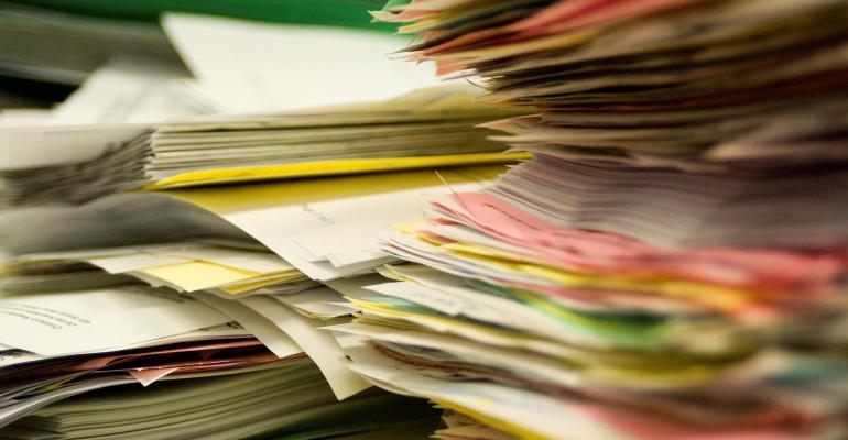 Paper in folders in piles or stacks