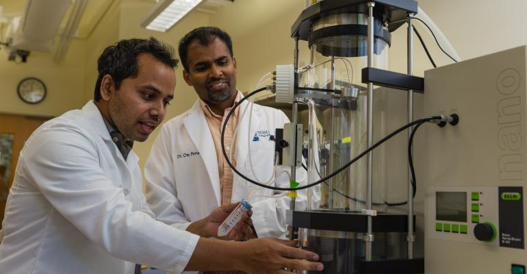 Pharmacy researchers using analytical equipment