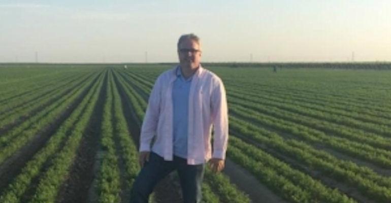 Randy Krotz standing in a field