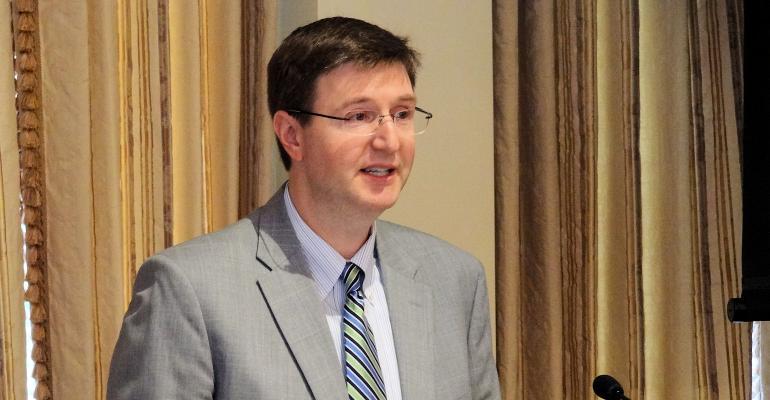 President ag adviser Ray Starling talks to NAAJ