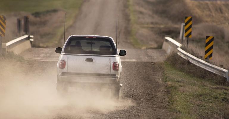 Rural bridge gravel road-GettyImages470913692.jpg