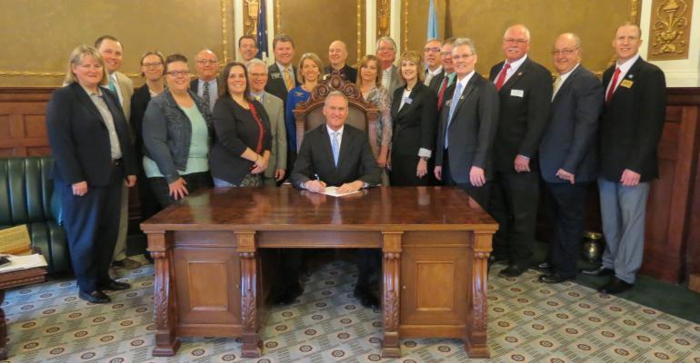 A reenactment of South Dakota Gov. Dennis Daugaard signing Senate Bill 172, which provides funding for SDADRDL renovations.