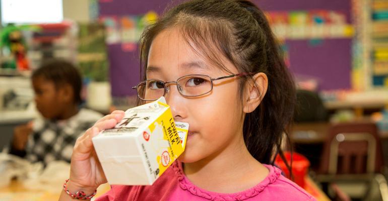 girl drinking school lowfat milk