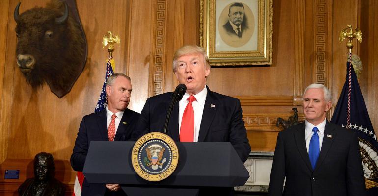 President Trump speaks with Interior Secretary Zinke and Vice President Pence