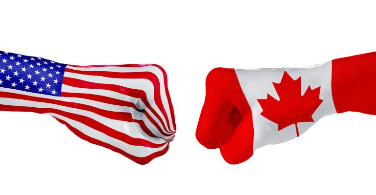 US and Canada flags in fist fight