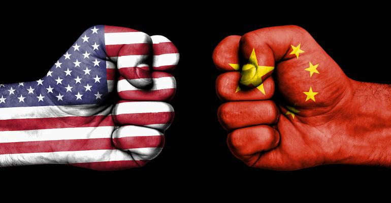 fists with U.S. and Chinese flags