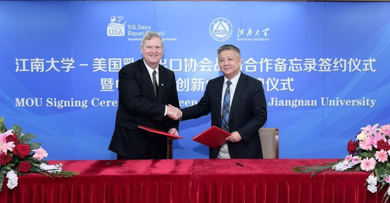 USDEC CEO Tom Vilsack celebrate dairy MOU in China