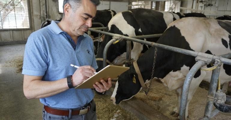 Victor Cabrera collecting on-farm data