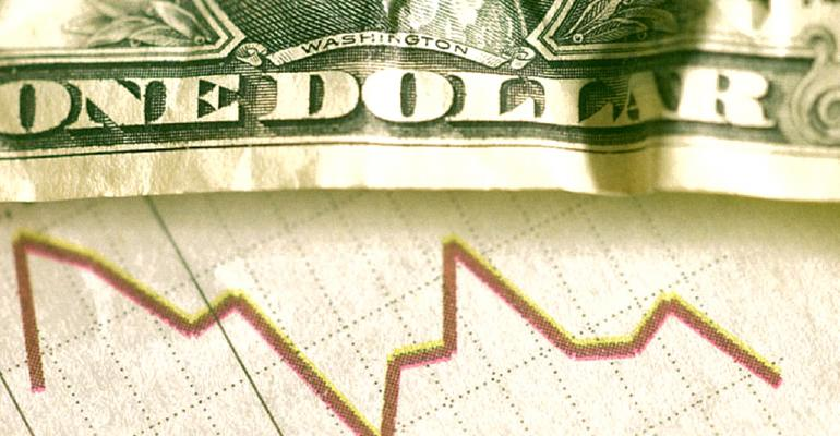 Dollar bill on top of business stock chart