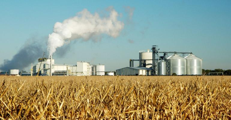 ethanol plant with corn field in the front