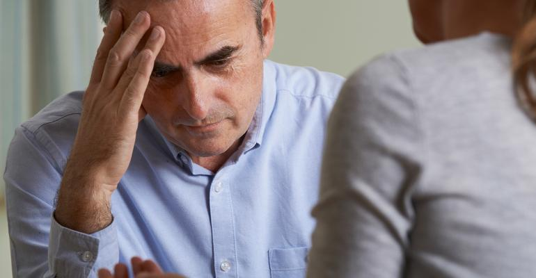 stressed man with counselor