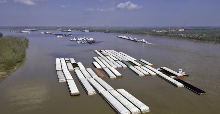 barges carrying grain down river