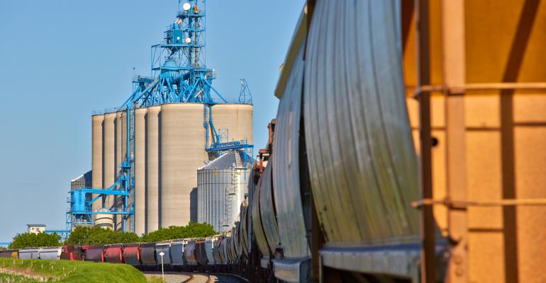 freight rail hoppers and grain silos