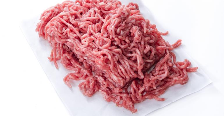 raw ground beef on white background