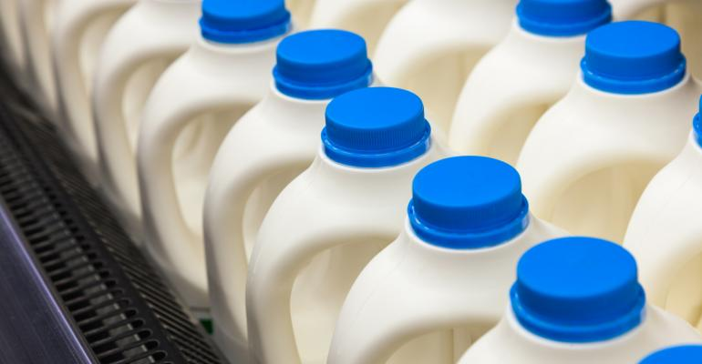 milk jugs in a dairy case_nanoqfu_iStock_Thinkstock-178769490.jpg