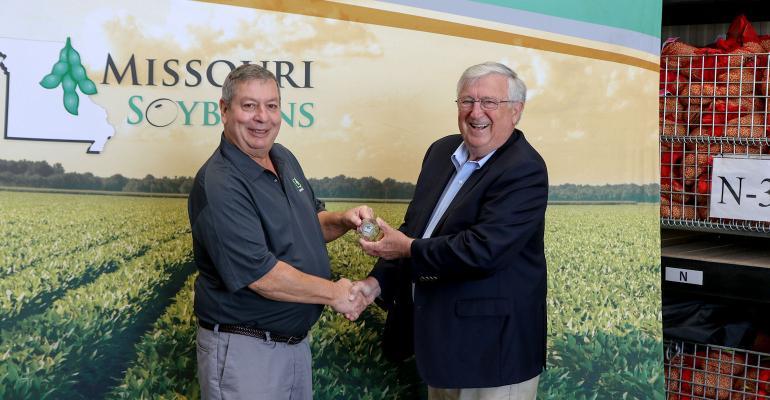 Missouri Soybean Merchandising Board chairman John Kelley and Schillinger Genetics Inc. president John Schillinger shake hands
