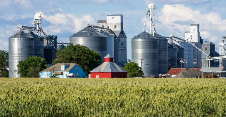 barn and grain bins near field edge
