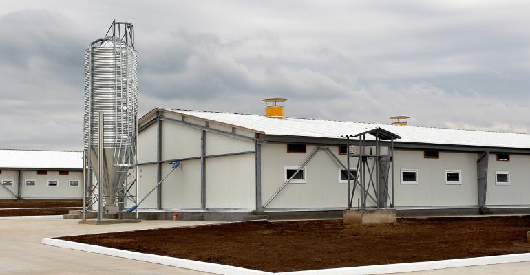 swine barn and feed bin on cloudy day_ALesik_iStock_Thinkstock-455175595.jpg
