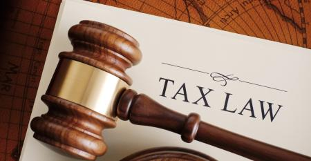 Judge's gavel lying on a tax law document